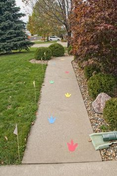 Dinosaur Birthday Party. Love the idea of creating a setting even before they get to the party!! Could use stars, sparkly fairy foot prints, balloon shapes, car tracks, candy canes, spiders webs - the list endless!!!