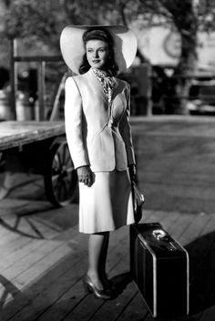 Ginger Rogers, 1942 That wide-brimmed hat and elegant skirt suit made Ginger Rogers look effortlessly pulled-together in 1942. Just check ou...  She looks breath taking.