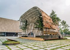 Rusty ship transformed into cavernous pavilion in Seoul