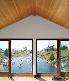 A boathouse on the first floor and a family home on the second, the Worple Residence floats on the surface of Lake Huron in Ontario, Canada. Photo by:Raimund Koch