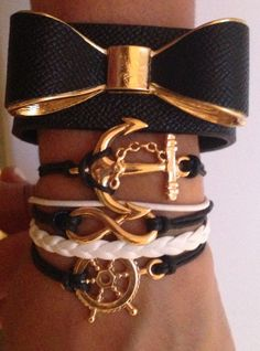 Arm Candy Set with black bow with gold trim and nautical layered bracelet (yacht life). Use sparingly for a more classic look. Perfect with a white tee and a pair of classic Jack Purcell's.