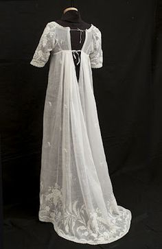 Breathtaking hand-embroidered mull dress with whitework embroidery and a rare train. It is also a near-perfect embodiment of the Neoclassical style. (1800-1810)