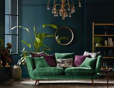 I love everything in this beautiful emerald green and brass living room. Except for the purple accent I love everything in this beautiful emerald green and brass living room. Except for the purple acce Living Room Accents, Living Room Green, Living Room Colors, Home Living Room, Living Room Designs, Bedroom Green, Bedroom Colors, Dark Living Rooms, Colourful Living Room