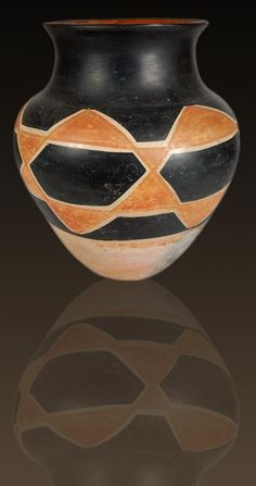 #adobegallery - Kewa Pueblo Black and Red on Cream Aguilar Jar by Asunción Aguilar Caté (ca.1880 – 1925) - Two sisters at Santo Domingo Pueblo were master potters who produced the standard black and cream ware of their pueblo. Their vessels were tall, slim water jars of the finest workmanship. Still, around 1910, sales of their pottery slowed.
