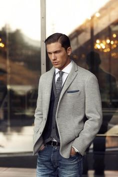 Shop this look on Lookastic: http://lookastic.com/men/looks/jeans-belt-cardigan-blazer-pocket-square-tie-long-sleeve-shirt/7218 — Navy Jeans — Black Leather Belt — Navy Vertical Striped Cardigan — Grey Knit Blazer — Navy Pocket Square — Charcoal Fair Isle Tie — White Long Sleeve Shirt