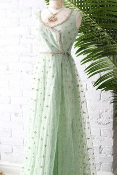 Mint Green Poppy Lane Wrap Gown with gold border and sequins detailing. This product only ships to Canada, U. Check out more on Indian Bridesmaid Dresses, Indian Gowns Dresses, Pakistani Dresses, Kurti Designs Party Wear, Kurta Designs, Indian Attire, Indian Outfits, Indian Designer Outfits, Designer Dresses