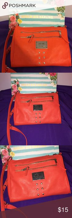 Nicole Miller Bright Orange Crossbody Purse Bright Orange Crossbody Bag with Long strap. Nice Spring/Summer Purse. It could actually be worn anytime of year if you live outside the box.   Notes: * The bag has small amount of visible smudges but they are faint. You can see them if your look up close. * The bag is new without tags and has never used * Bag comes my pet free/smoke free home. Nicole by Nicole Miller Bags Crossbody Bags