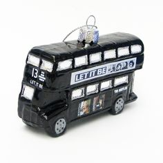 This glass ornament is fashioned after The Beatles™' Let It Be London bus.