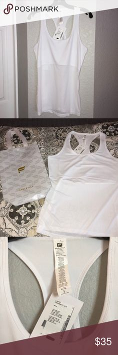 Fabletics Cashel Racerback Tank Faboetics Cashel Racerback Tank. White. Size Small. New with Tags. Start your new year off right working out in this beautiful fabletics Tank!! Fabletics Tops Tank Tops