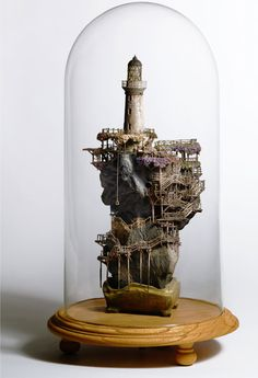 "Takanori Aiba decades it works great, is the world of illustration or architecture, but it was sensational creating ""mini-worlds"" which seems to have met. Houses in bonsai, lighthouses, castles and even a Michelin bonecão are in a spectacular range of parts."