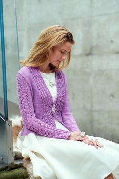 Embrae, a fitted cardigan with a lace collar, is like a flowery embrace. A lacy leaf pattern adorns the sleeves and the back of the cardigan. Find this beautiful pattern and more knitting inspiration at LoveKnitting.Com.