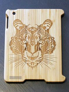 Tiger by Kingsley Nebechi on bamboo iPad case for smart cover by Etch, great detail in the laser etching etchwork.com
