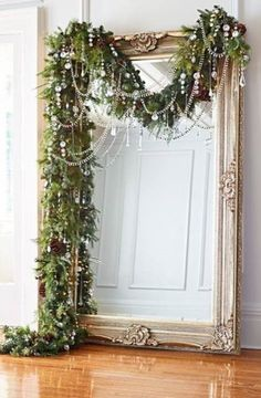 I want a mirror like this at the top of out stairs.... and what a way to decorate it at christmas