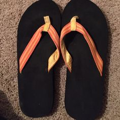 WORN ONCE Comfy Flip Flops Worn only once, with cute shades of orange stripes. Shoes Sandals