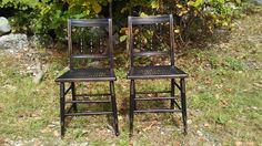 A pair of vintage chairs painted black with newly caned seats. https://www.facebook.com/AVintageWren