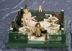 14 (36 cm.) German Wooden Garden with Furnishing and Dollhouse Dolls 200/400