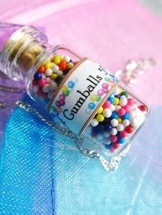 Hey, I found this really awesome Etsy listing at https://www.etsy.com/listing/80692950/gumballs-rainbow-candy-jar-necklace