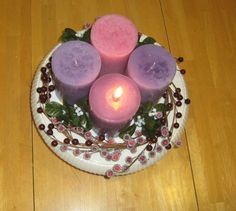 One of my favorite Catholic traditions is the Advent Wreath (read more about it here ). Basically, it's a wreath with four candles (three pu. Homemade Advent Wreath, Advent Wreaths, Catholic Traditions, Christmas Crafts, Centerpieces, Candles, Winter Solstice, Spirals, Traditional
