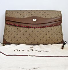 GUCCI Clutch - Tan Brown Vintage Gucci monogrammed Accessory Collection Purse -  Authentic Made in Italy Red and Green. $160.00, via Etsy.  *Moth Eaten Deer Head