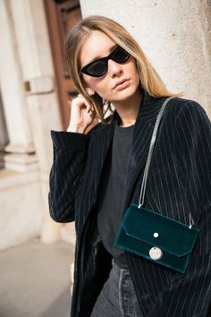 During fashion week, one must pare down the essentials to what fits in the perfect shoulder bag. For Chiara Capitani, that's a velvet green Jimmy Choo gem. Find yours now on Farfetch.
