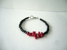 Black and red coral beaded bracelet minimal style by elenasaglfe