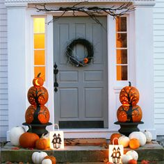 Halloween Pumpking Pillars- Leave the tops off all but the smallest pumpkin.  Create a spooky tree using marker, the stars look is created by drilling holes.