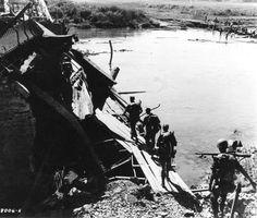 WWII soldiers push deeper into central Burma around demolished tank blocking bridge. Photographer Unknown