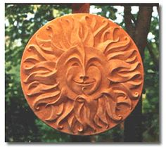 """Milagro Del Sol - """"Miracle of the Sun""""  Dancing Fire Inc.  This hand-sculpted sun face is an original work of art."""