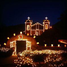 Christmas farolitos line the Sanctuary Chimayo, NM