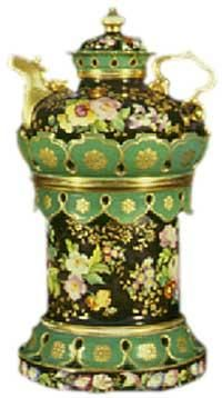 Teapot #147  Black background, green and gold embossed decorations with encrusted roses; green and gold scalloped crown and valance; gold spout and handle on conforming teapot. Very rare. Jacob Petit.