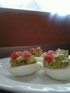 Avocado deviled eggs...3 hard boiled eggs (halved with yolks scooped out; mash using only 2 yolks), 1 small avocado; pitted & mashed, 2tbs turkey bacon bits (optional), 1 large garlic clove, finely minced, half of 1large tomato, seeded & chopped (reserve 1/2 of chopped tomato for garnish), squeeze of fresh lemon juice, salt & pepper to taste. Setting egg whites aside, mix all ingredients together, fill hollowed egg whites and garnish with chopped tomato. Yum! Avocado Egg Recipes, Avocado Deviled Eggs, Hard Boiled, Boiled Eggs, Garlic Clove, Turkey Bacon, Bacon Bits, Egg Whites, Fresh Lemon Juice