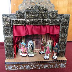 "Toy theatre made from a trash picked drawer. The curtains pull shut and there are 22 ""actors"" and 4 scenes to play with."
