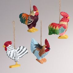 Just love all of their beautiful colors. Wouldn't these be a great pop of color on a tree? ::: Wood Rooster Ornaments from World Market