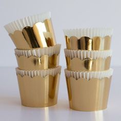 """Previous pinner: """"Round Gold Crown Baking Cups / Bake it Pretty"""" -- These lovely cups """"are the perfect size for [serving] nuts, candy, or hors d'oeuvres,"""" in addition to baking."""