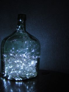 Twinkle lights in a glass jug...magical summer party decoration!