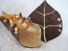this could be done with various shaped leaves in different fall colors.  Woodland Leaf Cuffs in Brown and Gold by AncientGrove on Etsy