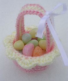The baskets are about 1 ½ inches tall, and 2 inches across, not including the shell edging. Taking into account the length of the handle, the total height would be about 3 ½ inches. They are just large enough to hold a handful of jellybeans, or one Easter egg. Crocheted in continuous rounds, these miniature baskets are fast and easy to complete!