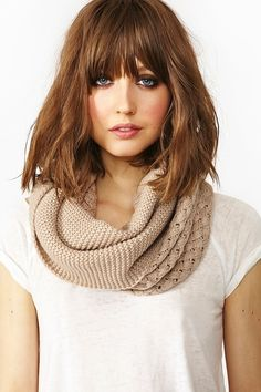 Medium Wavy Hairstyle with Blunt Bangs