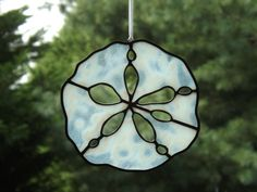Absolutely cute! This Sand dollar measures 5 high and 5. wide. I used a beautiful white mottled Youghiogheny glass. This suncatcher is framed