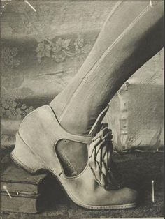 Her shoe with stocking run and books-1930
