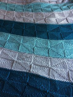 """Free Knitting Pattern for Reversible Windmill Blanket - This easy College Afghan is knit with a pinwheel or windmill stitch of triangles that is completely reversible. Finished measurements: 58"""" x 80"""" Knit with 2 strands of worsted held together. Designed by Jane Wiewora. Rated very easy by Ravelrers. Pictured project by db7506 who knit the blanket in stripes but you can knit it of a solid color."""