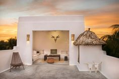 in Holbox , MX. Casa Impala is an exclusively private  duplex retreat nestled amongst a luxuriant palm grove , and is ideally located a few steps from the beach and a few minutes from the town center of the island .