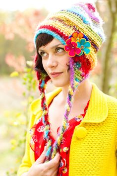 Design Your own Whimsy Gnome Slouchy Hat -- I wouldn't want the pointy top, but slouchy is great. Don't like flowers, either. Maybe a rainbow, or something else. Love all the random colors and the ear flaps.