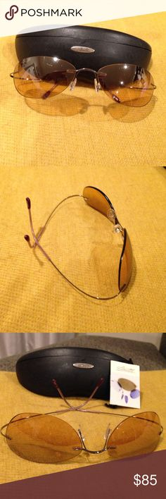 Silhouette Sunglasses- Lightweight, frameless. Silhouette sunglasses-100% UV protection. Original case/paper. Amber colored, frameless lens. Slightly worn/scratches but in good condition. Ultra light!!! Hingeless, tension wire arms. Made in Austria. Silhouette Accessories Sunglasses