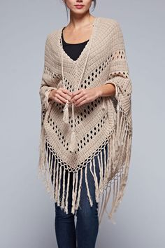 This bohemian inspired crochet poncho has a long tassel tie in front and long fringed hemline. Ultra soft cotton/acrylic blend yarn in a soft, neutral tone to compliment your spring and summer outfits Más Crochet Scarves, Crochet Shawl, Crochet Yarn, Crochet Clothes, Crochet Stitches, Crochet Woman, Love Crochet, Irish Crochet, Crochet Capas