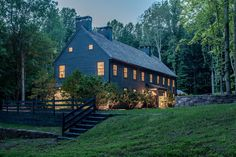 Modern home with Exterior, Farmhouse Building Type, Gable RoofLine, and Wood Siding Material. To me, homes sleep during the day and come to life at night. Photo 15 of The Lodge Modern Farmhouse Exterior, Rustic Design, Building Design, Future House, Acre, House Plans, New Homes, Villa, House Design