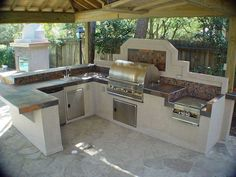 Features outdoor kitchen designs pictures