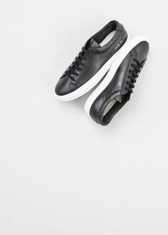 """Woman By Common Projects BLACK ORIGINAL ACHILLES WHITE SOLE SNEAKER  Low-cut sneaker in black leather with a rounded toe. 1"""" platform in white rubber. Lace-up closure. Gold lettering detail on outer heel. Dust bag and extra laces included."""