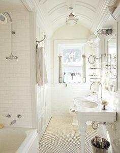 White bathroom, subway tiles for the shower walls, white brick