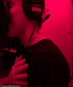 Singing his heart out: David Beckham shared a cute Instagram snap of his 11-year-old singing into a microphone at producer Rodney Jerkins' studio